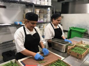 Two 2017 Project Okra Chef working at Albert's Worsley